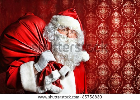 Portrait of Santa Claus with a bag of presents. Christmas. - stock photo