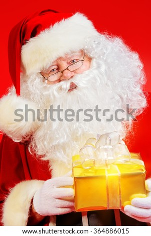 Portrait of Santa Claus with a gift. Christmas. - stock photo