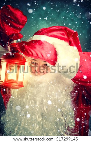 Portrait of Santa Claus with latern. Authentic Santa Claus. Christmas fantasy.