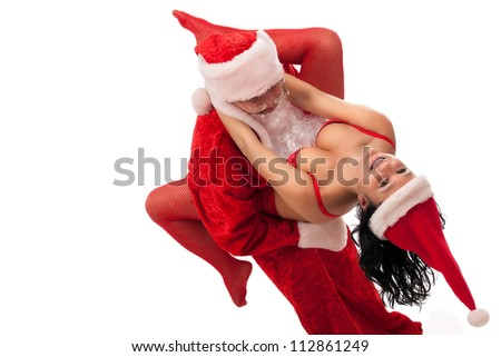 Portrait of Santa Claus with sexy girl in Santa hat. Isolated on white. - stock photo