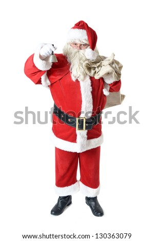 portrait of santa clause ringing the bell - stock photo