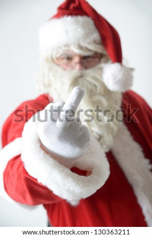 portrait of santa clause showing his middle finger - stock photo