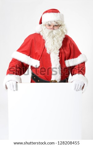 portrait of santa clause with advertising sign - stock photo