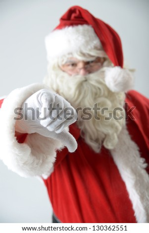 portrait of santa clause with thumbs down - stock photo