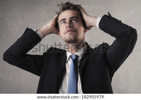 portrait of satisfied businessman with hands in hair