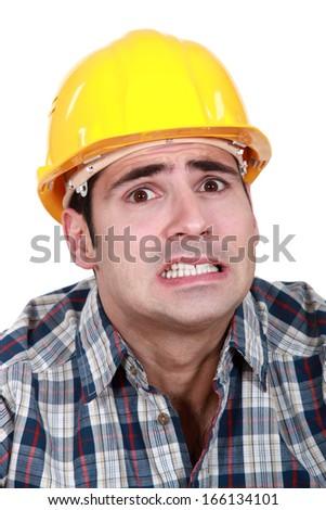 Portrait of scared laborer - stock photo