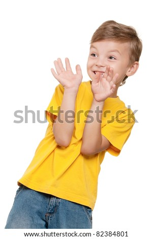 Portrait of scared little boy over white background