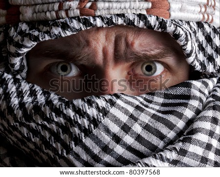 Portrait of scared middle eastern man looking to you - stock photo