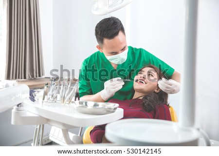 portrait of scared patient close her mouth at dentist clinic. dental care problem