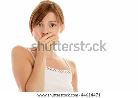 Portrait of scared woman covering mouth with hand isolated on white background