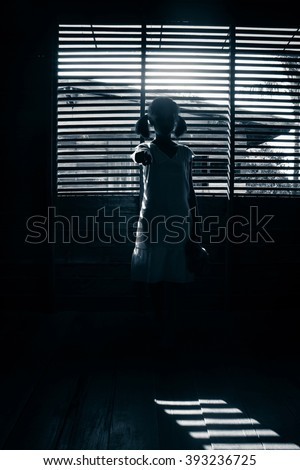 Portrait of scary girl pointing hand at cameras,Ghost girl hiding from the dark,Horror background for halloween  - stock photo