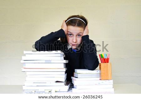 portrait of school girl and homework - stock photo