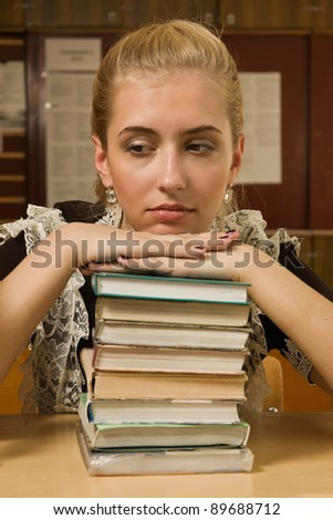 portrait of  school girl in a classroom - stock photo