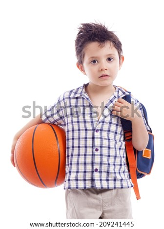 Portrait of school kid holding a basket ball, isolated on white background - stock photo