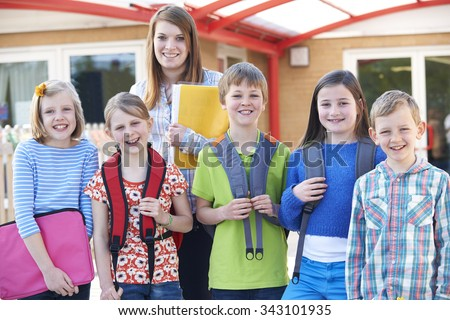 Portrait Of School Pupils Outside Classroom With Teacher - stock photo