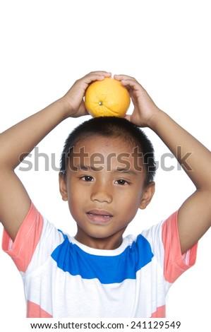 portrait of schoolboy with orange  - stock photo