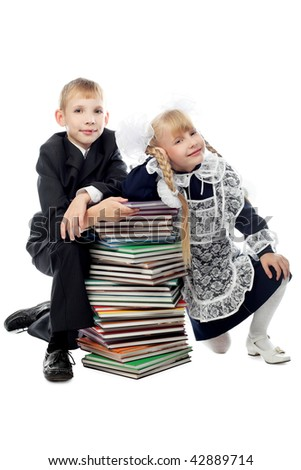 Portrait of schoolchildren with a stack of books.