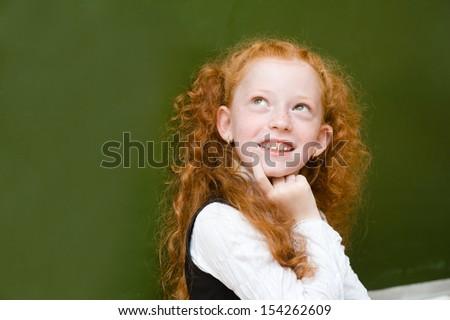 portrait of schoolgirl looking up - stock photo