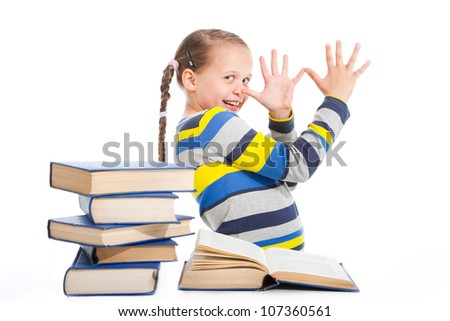 portrait of schoolgirl with books cheerfully being teased on isolated white background - stock photo