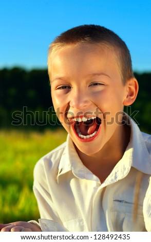 Portrait of Screaming Boy in Summer Fields - stock photo