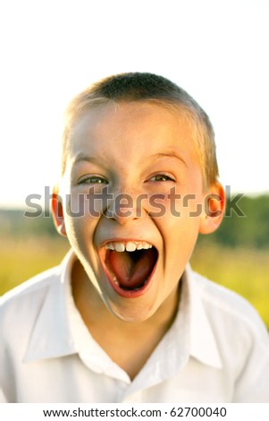 portrait of screaming boy outdoor - stock photo