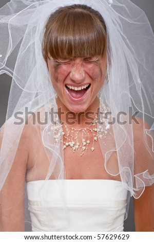 portrait of screaming bride over grey background - stock photo