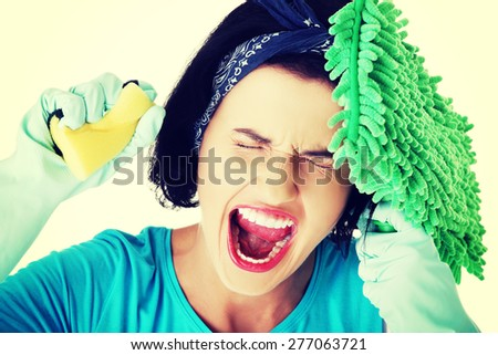 Portrait of screaming woman with a mop and sponge. - stock photo