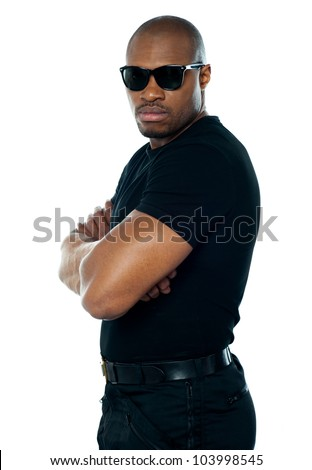 Portrait of secret agent standing with hands folded on white background - stock photo