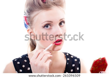 Portrait of seductive blonde pinup girl draws red lip liner closeup on white background - stock photo