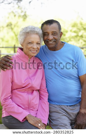 Portrait Of Senior African American Couple Wearing Running Clothing In Park - stock photo