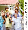 Portrait of senior and young couples with children outdoors by their cottage - stock photo