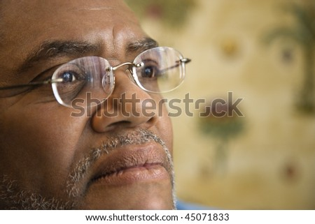Portrait of senior black man in eyeglasses with serious expression.  Horizontal shot. - stock photo