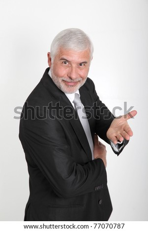 Portrait of senior businessman showing thumbs up - stock photo