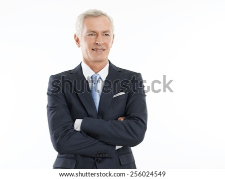 Portrait of senior businessman standing against white background.  - stock photo