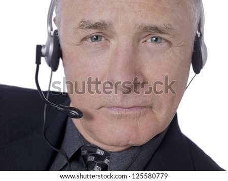 Portrait of senior businessman wearing headset against white background