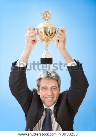 Portrait of senior businessmen holding a trophy on sky - stock photo