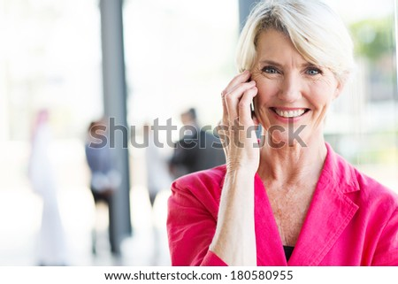 portrait of senior businesswoman talking on cell phone  - stock photo