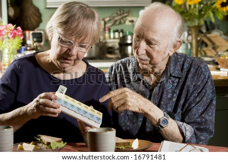Portrait of Senior Couple Discussing Medications - stock photo