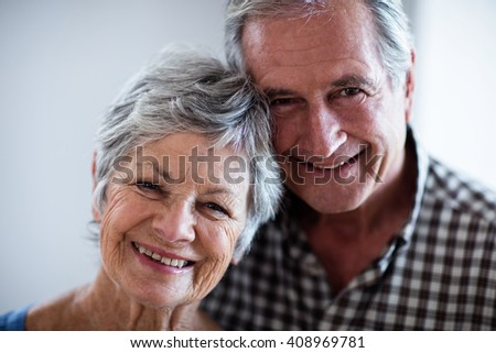 Portrait of senior couple smiling at home - stock photo