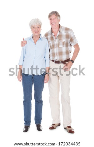 Portrait Of Senior Couple Smiling Over White Background - stock photo