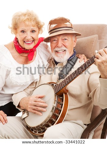 Portrait of senior couple who play banjo and sing country music.