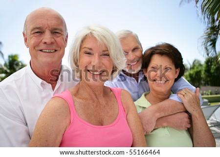 Portrait of senior couples smiling - stock photo