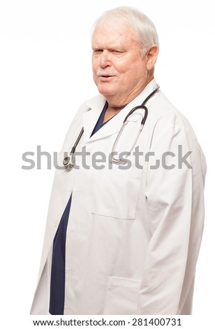 Portrait of senior doctor standing against white background with funny expression on face. Isolated on white background.