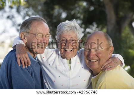 Portrait of senior friends smiling. Horizontally framed shot. - stock photo