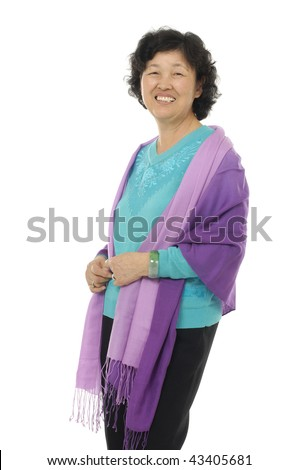 portrait of senior happy woman standing with hands folded over white background - stock photo