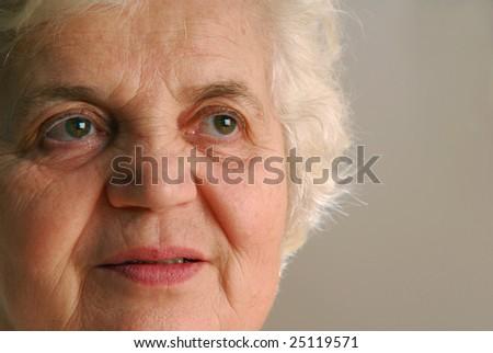 Portrait of senior lady, extreme close-up - stock photo
