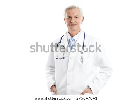 Portrait of senior male doctor standing against white background while looking at camera and smiling.  - stock photo