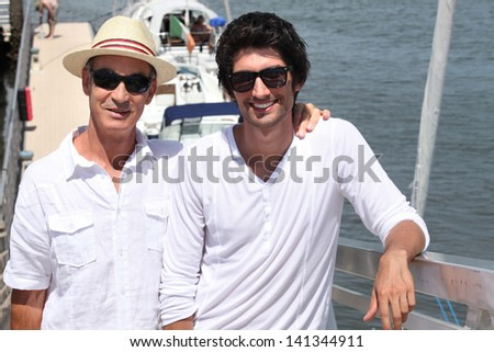 Portrait of senior man and young man - stock photo