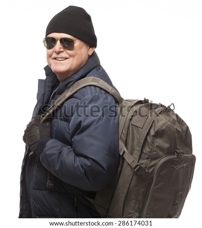 Portrait of Senior Man Hiking with Backpack and smiling.