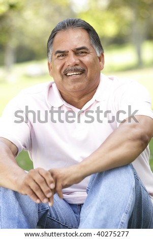 Portrait Of Senior Man In Park - stock photo
